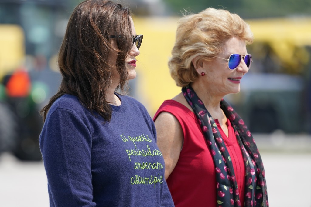 Sen. Debbie Stabenow, D-Mich., right, and Michigan Gov. Gretchen Whitmer wait to greet President Joe Biden as he arrives at Cherry Capital Airport, Sa...