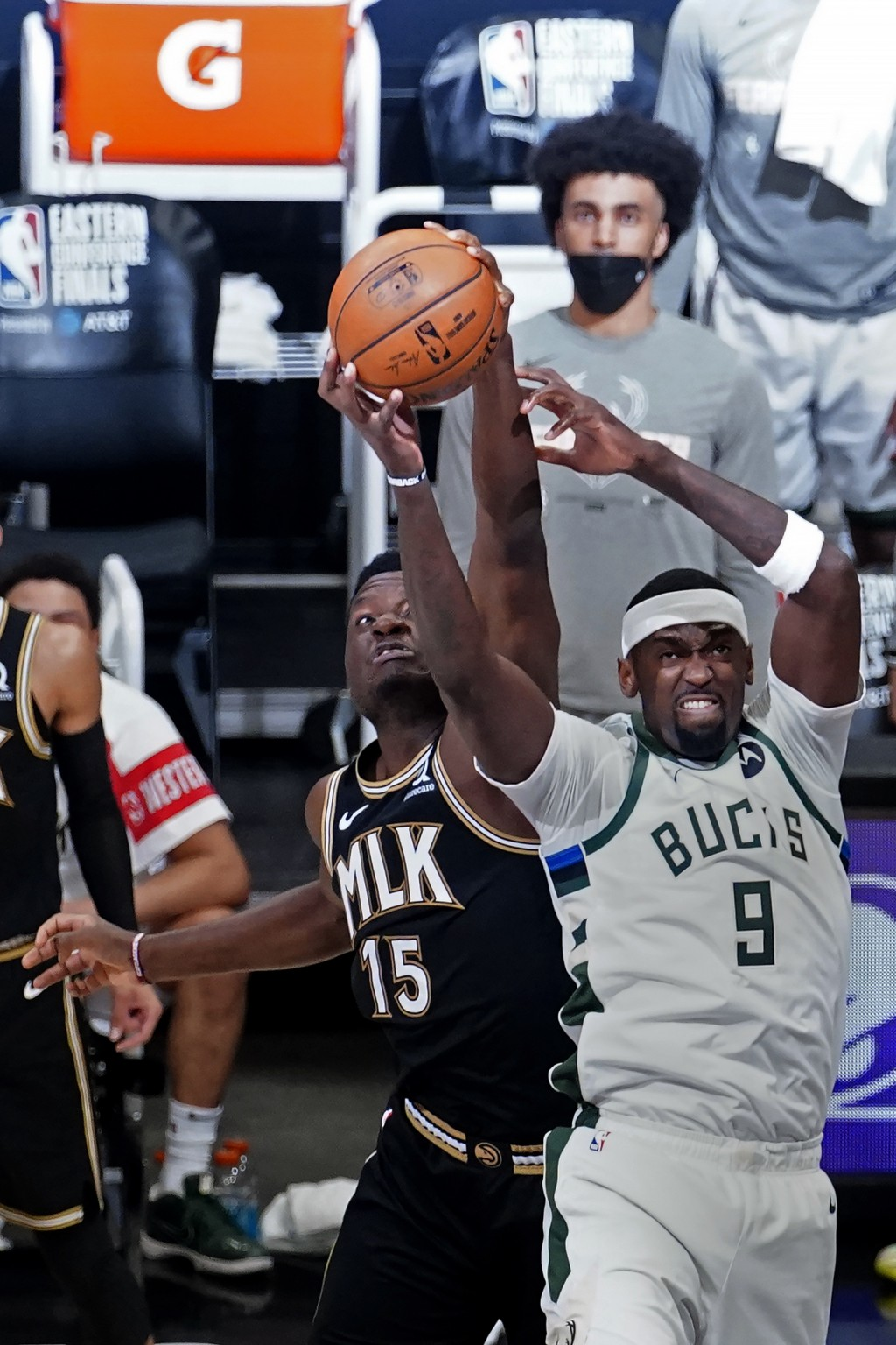 Milwaukee Bucks center Bobby Portis (9) and Atlanta Hawks center Clint Capela (15) reach for a rebound during the first half in Game 6 of the Eastern ...