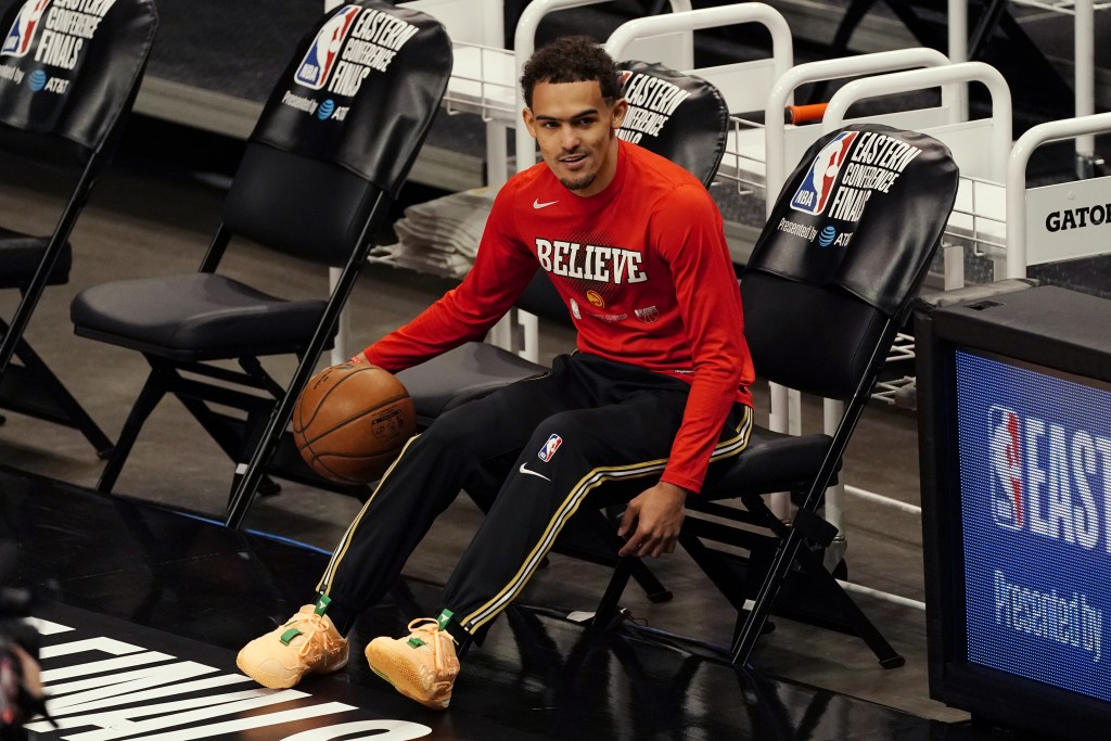 Atlanta Hawks guard Trae Young warms up before Game 6 of the team's NBA basketball playoffs Eastern Conference finals against the Milwaukee Bucks, Sat...