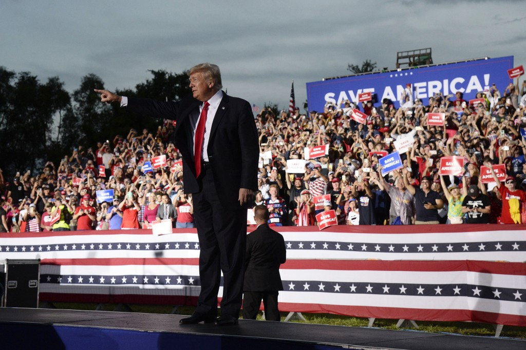 Former President Donald Trump walks on stage during a rally at the Sarasota Fairgrounds Saturday, July 3, 2021, in Sarasota, Fla. (AP Photo/Jason Behn...