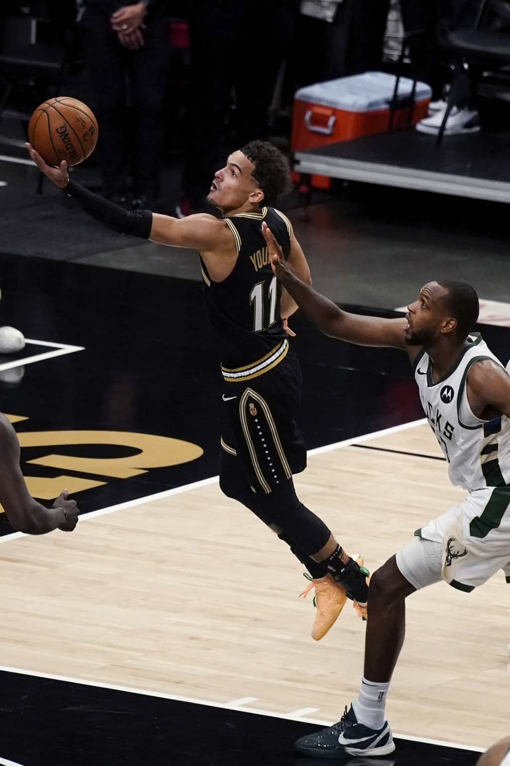 Atlanta Hawks guard Trae Young (11) shoots next to Milwaukee Bucks forward Khris Middleton (22) during the second half of Game 6 of the Eastern Confer...