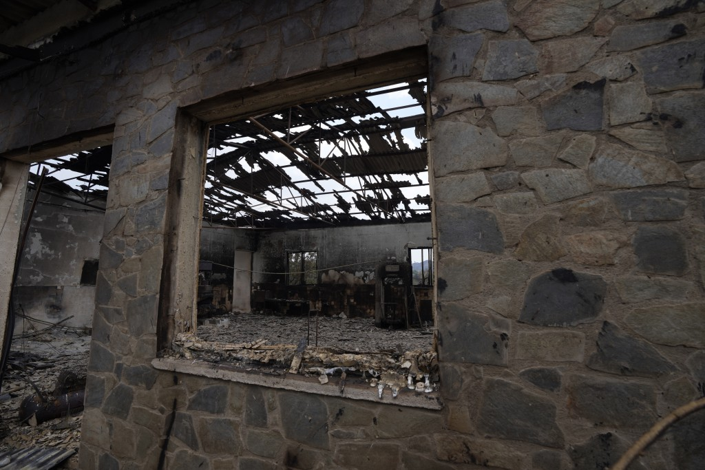 A burned house is seen on Troodos mountain, in Ora village, southwestern Cyprus, Sunday, July 4, 2021. Cyprus search crews discovered the bodies of fo...