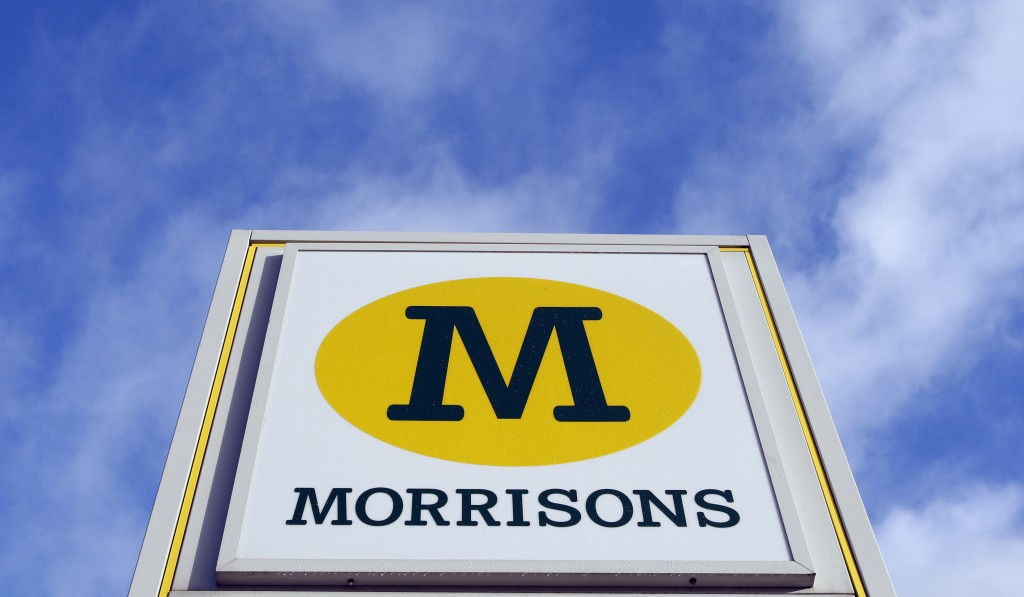 FILE  - In this Thursday, Dec. 4, 2008 file photo, a view of a Morrisons sign, at a  supermarket is seen in London, Thursday, Dec. 4, 2008. Morrisons,...