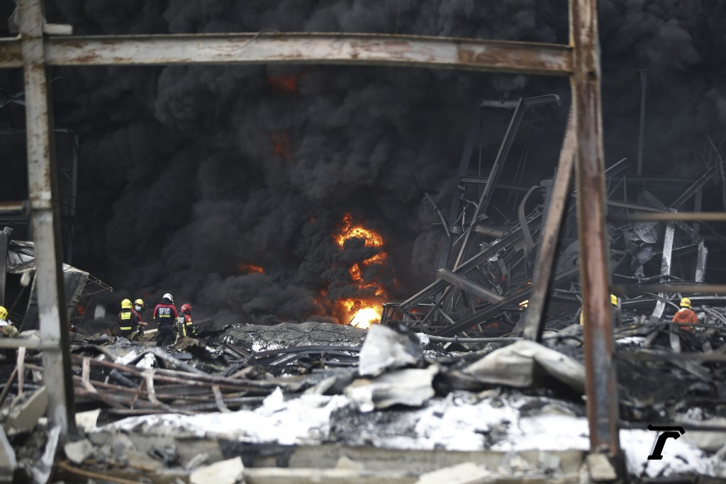 Firefighters work at the site of a massive explosion in Samut Prakan province, Thailand, Monday, July 5, 2021. A massive explosion at a factory on the...