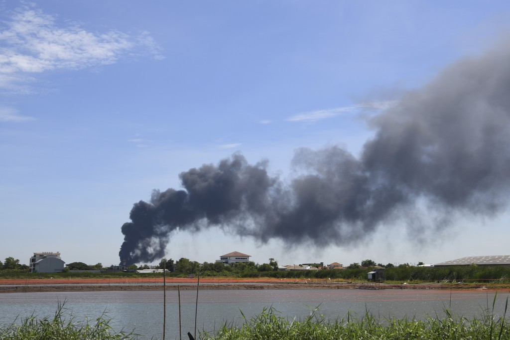 Smoke rises into the air from a factory in Samut Prakan province, Thailand, Monday, July 5, 2021. A massive explosion at the factory on the outskirts ...