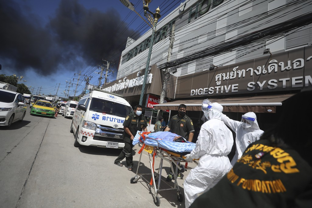 Patients are evacuated from the Chularat 9 Hospital following a massive explosion and fire at a factory in the Samut Prakan province, Thailand, Monday...