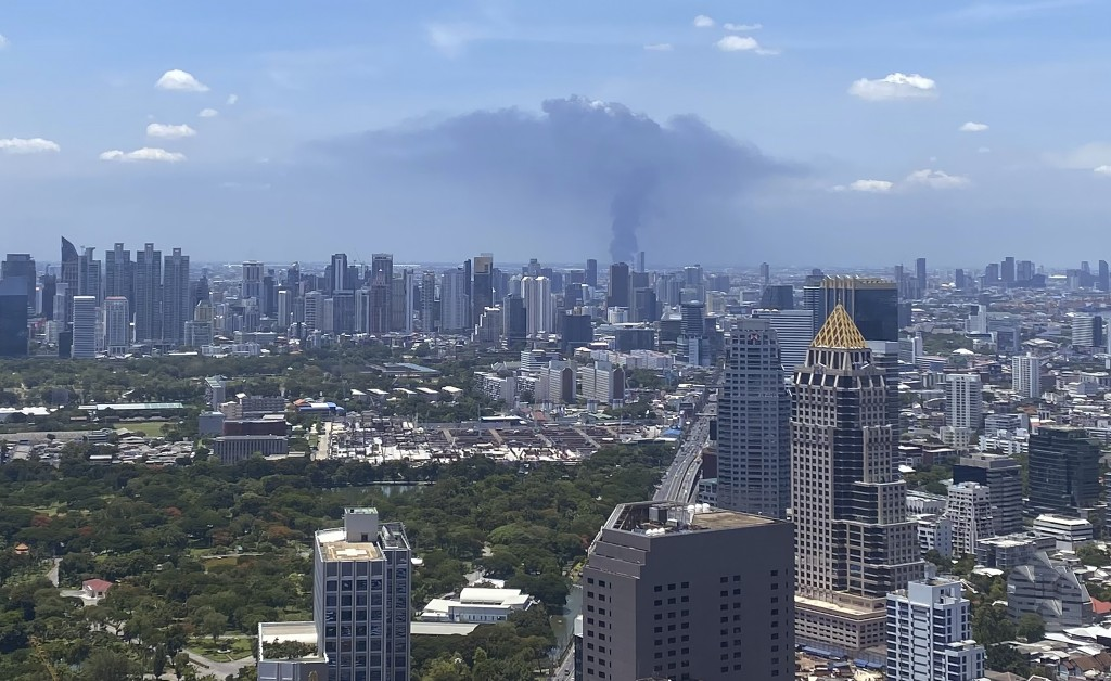 In a view from downtown Bangkok, giant plumes of smoke can be seen rising from the Samut Prakan province area in central Thailand, Monday, July 5, 202...