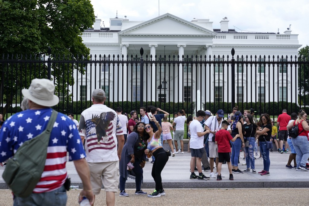 People gather on a section of Pennsylvania Avenue that was reopened to the public in front of the White House, Sunday, July 4, 2021, in Washington. (A...