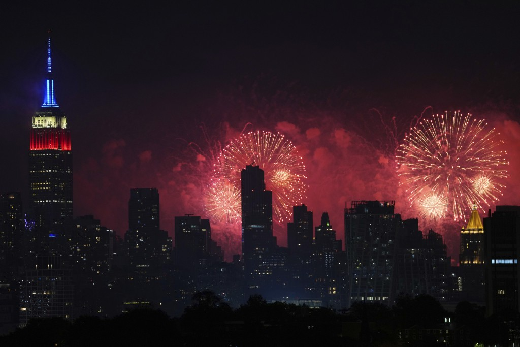 Fireworks explode over the New York City skyline during Macy's 4th of July fireworks display, late Sunday, July 4, 2021, as seen from Jersey City, N.J...