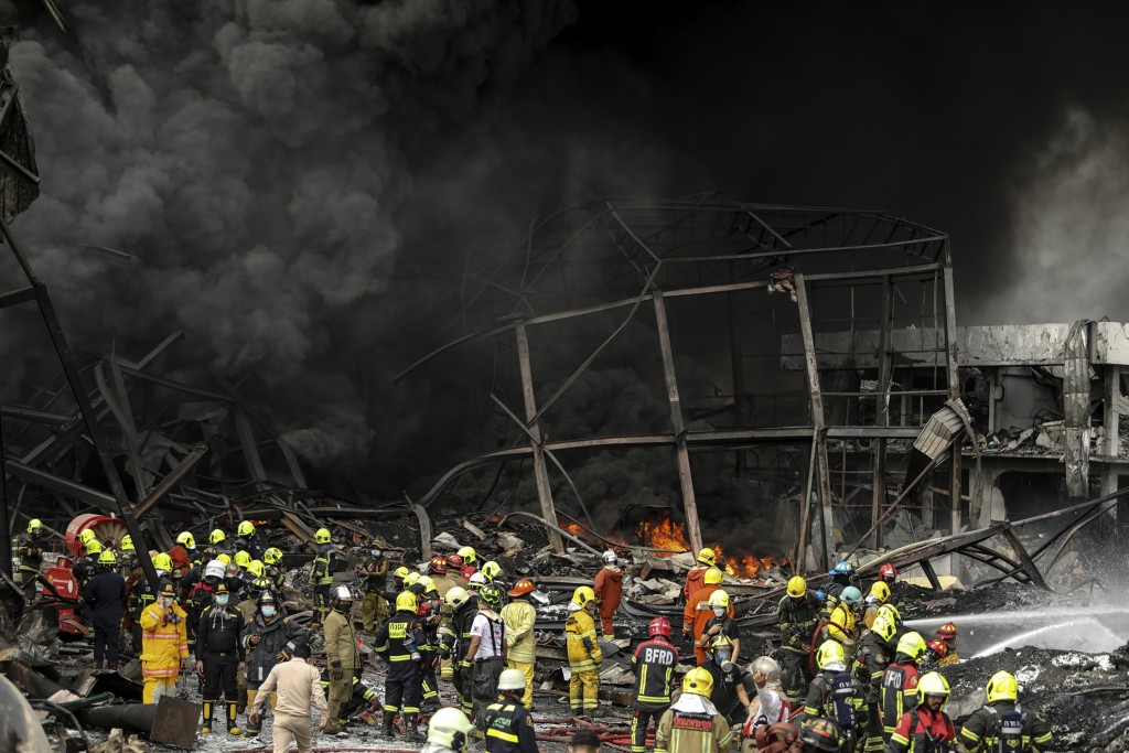 Firefighters work at the site of a massive explosion in Samut Prakan province, Thailand, Monday, July 5, 2021. The massive explosion at a factory on t...