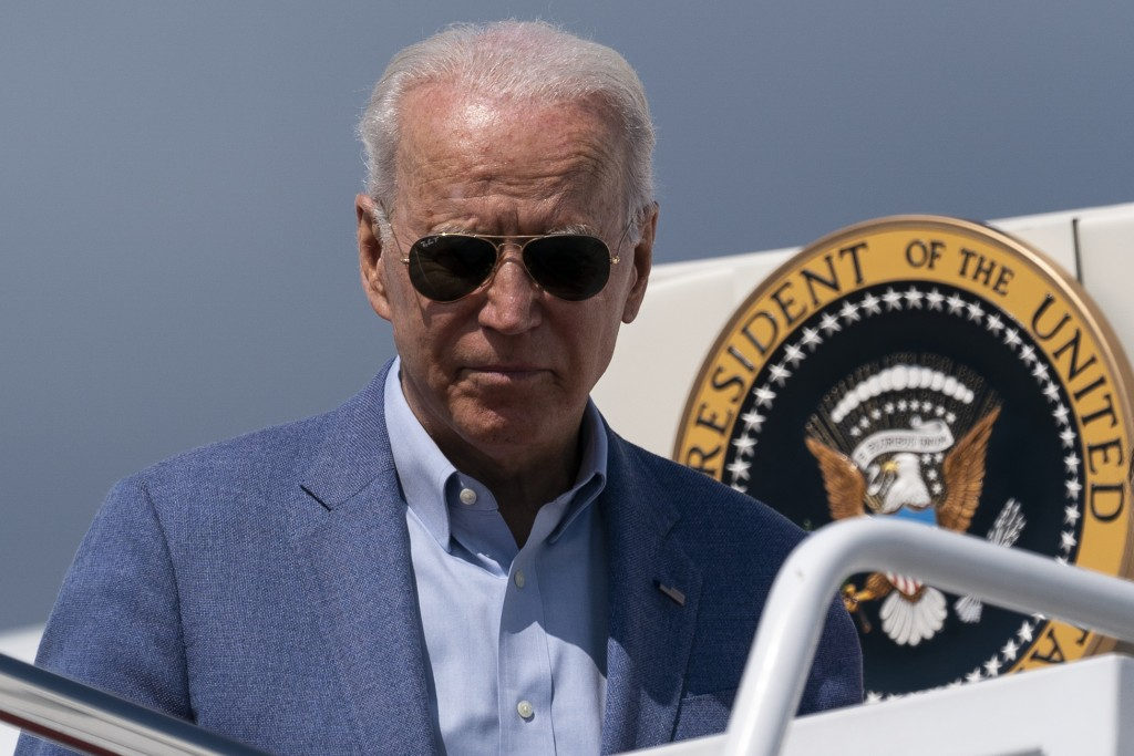 President Joe Biden steps off Air Force One upon arrival, Sunday, July 4, 2021, at Andrews Air Force Base, Md. (AP Photo/Alex Brandon)