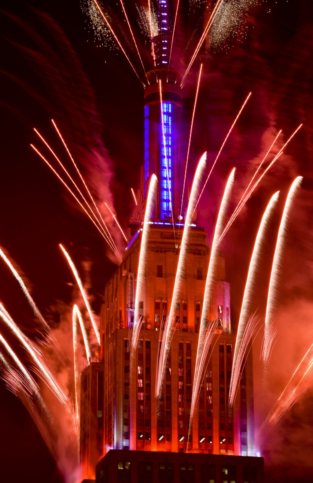View of the Macy's 4th of July fireworks display launched from the Empire State Building, late Sunday, July 4, 2021, in New York. (Photo by Evan Agost...
