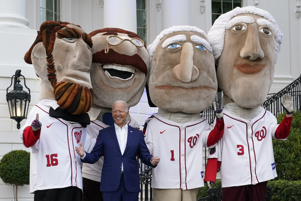 President Joe Biden visits with members of the Washington Nationals' Racing Presidents after speaking at an Independence Day celebration on the South ...