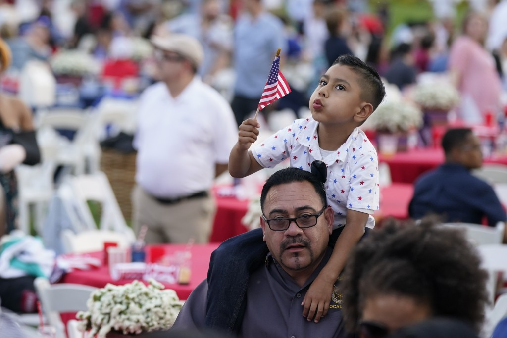 Attendees wait to hear President Joe Biden speak during an Independence Day celebration on the South Lawn of the White House, Sunday, July 4, 2021, in...