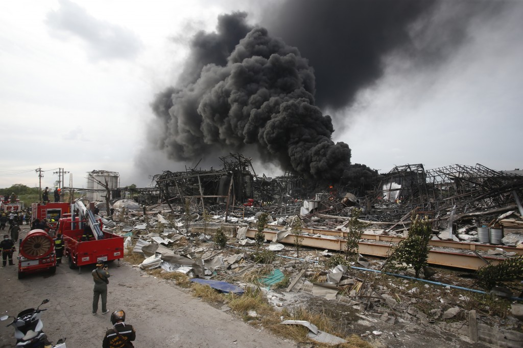 Firefighters work to extinguish a fire at the site of a massive explosion in Samut Prakan province, Thailand, Monday, July 5, 2021. A massive explosio...
