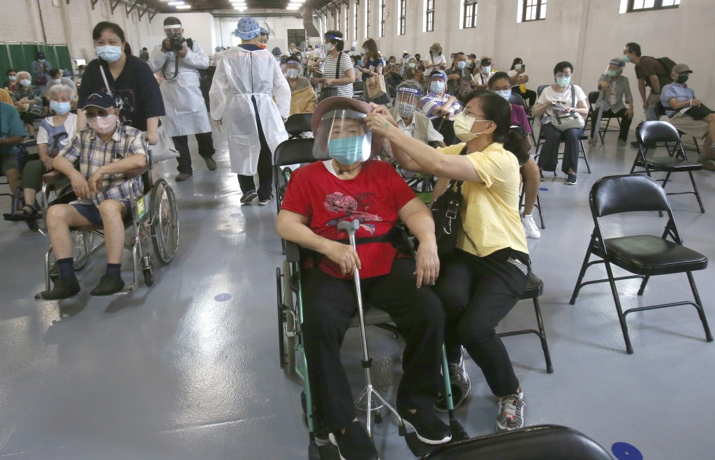 Elderly residents rest after AstraZeneca vaccination at Songshan Cultural and Creative Park in Taipei, Taiwan.