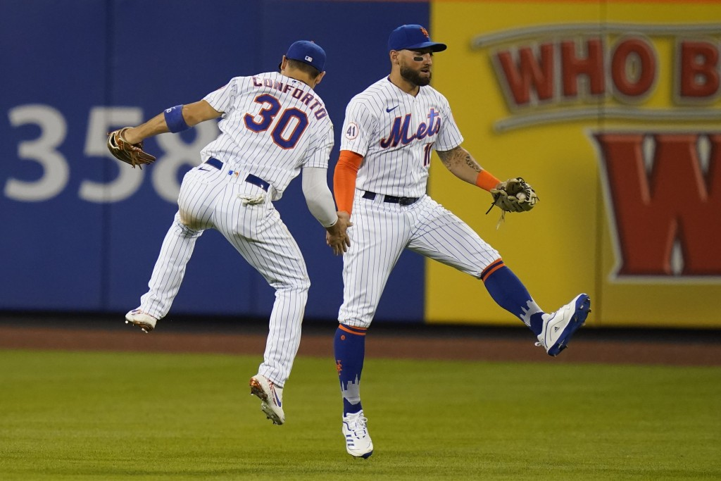 New York Mets' Michael Conforto (30) celebrates with Kevin Pillar (11) after a baseball game against the Milwaukee Brewers, Monday, July 5, 2021, in N...