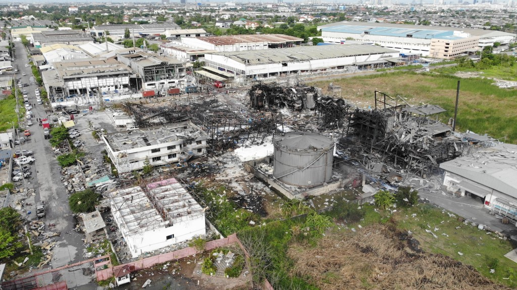 In this drone aerial photo provided by the Disaster Response Associations Thailand, twisted metal frames are all that remains of a burnt chemical fact...