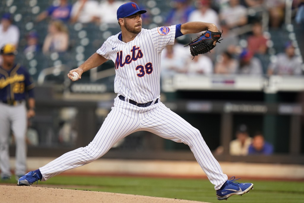 New York Mets' Tylor Megill delivers a pitch during the first inning of a baseball game against the Milwaukee Brewers, Monday, July 5, 2021, in New Yo...