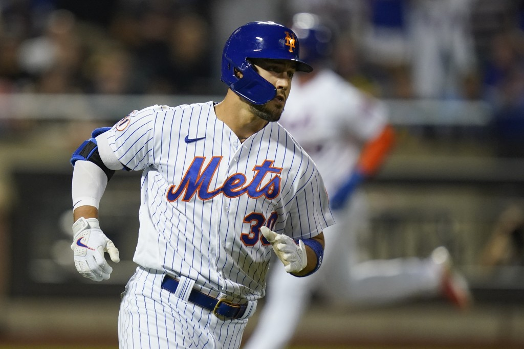 New York Mets' Michael Conforto (30) runs to first base for an RBI single during the seventh inning of a baseball game against the Milwaukee Brewers, ...