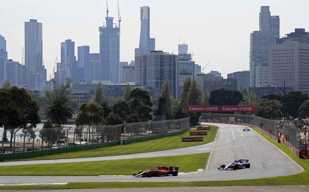 FILE - In this March 16, 2019, file photo, Formula One cars race on the circuit during the final practice session for the Australian Grand Prix in Mel...