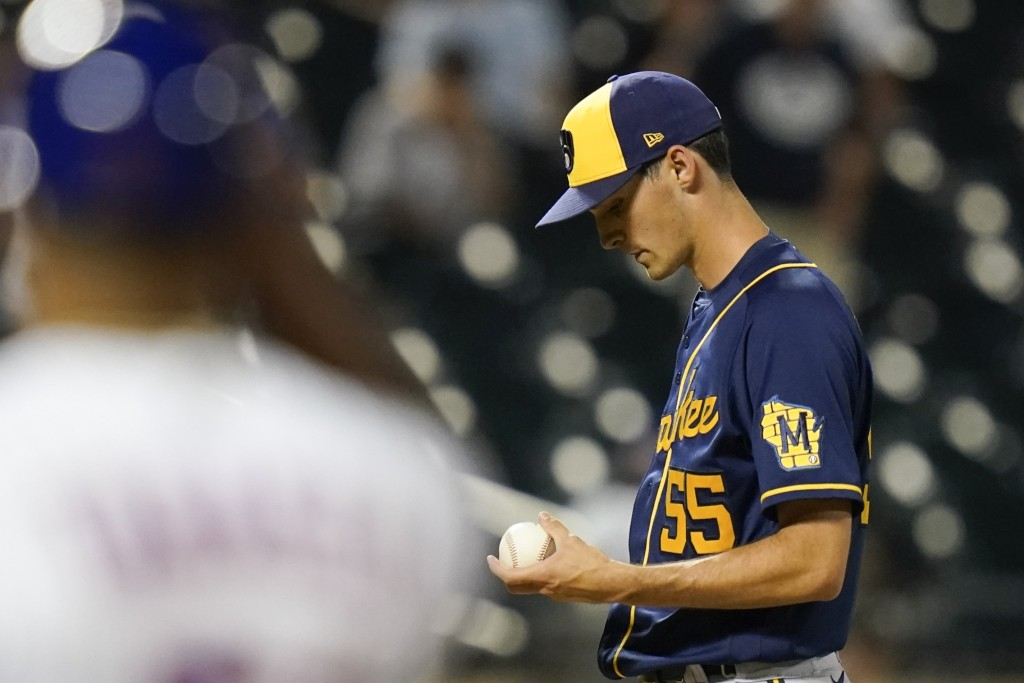 Milwaukee Brewers relief pitcher Hoby Milner (55) reacts after walking New York Mets' Francisco Lindor during the eighth inning of a baseball game Mon...