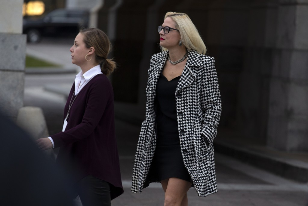 FILE - In this Feb. 5, 2020, file photo, Sen. Kyrsten Sinema, D-Ariz., departs after the impeachment acquittal of President Donald Trump, on Capitol H...