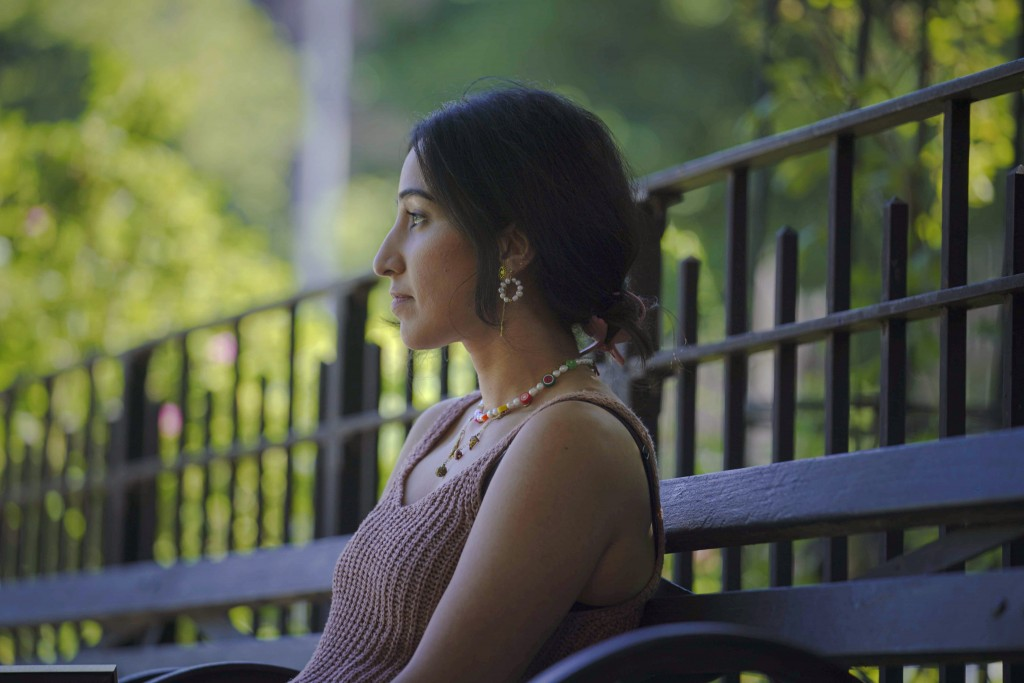 Noreen Wasti sits in a park near her home, Thursday June 24, 2021, in Brooklyn, N.Y. Wasti lost her father Salman Wasti, 76, a retired biology profess...