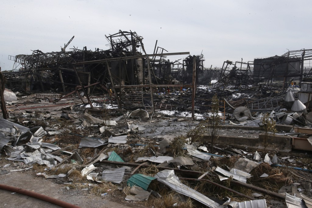 Twisted metal frames and debris are scattered on the site of a burnt chemical factory Tuesday, July 6, 2021 in Samut Prakan, Thailand. Firefighters fi...