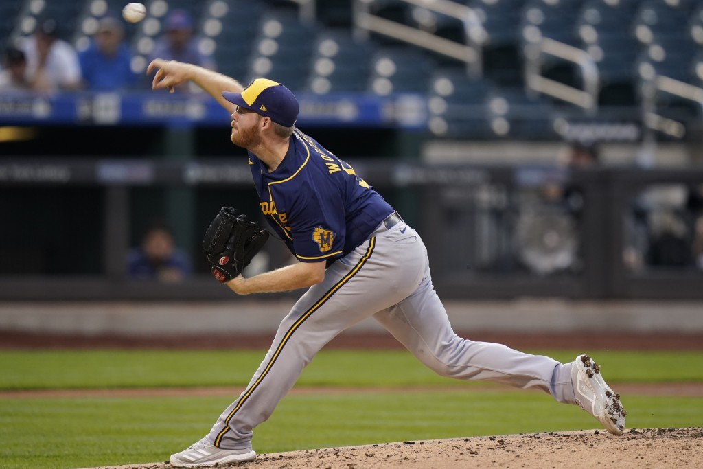 Milwaukee Brewers' Brandon Woodruff delivers a pitch during the second inning of a baseball game against the New York Mets, Monday, July 5, 2021, in N...