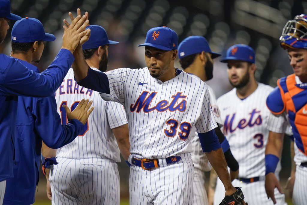 New York Mets relief pitcher Edwin Diaz (39) celebrates with teammates after a baseball game against the Milwaukee Brewers, Monday, July 5, 2021, in N...