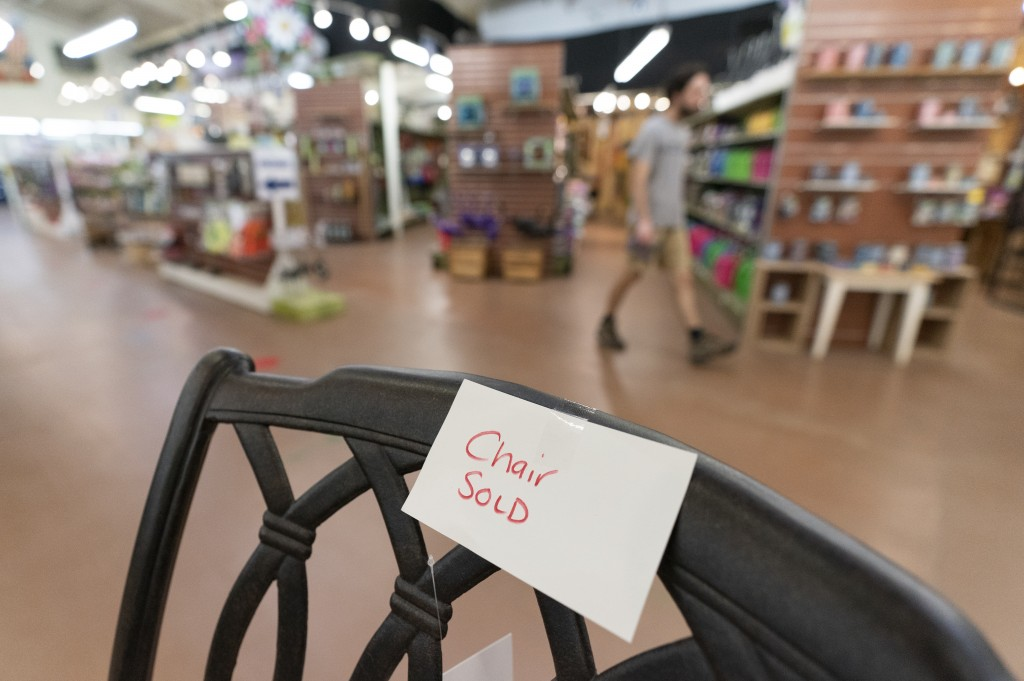 In this July 6, 2021, photo a sign is seen on a sold patio furniture floor model at Valley View Farms in Cockeysville, Md.. The garden supply store in...