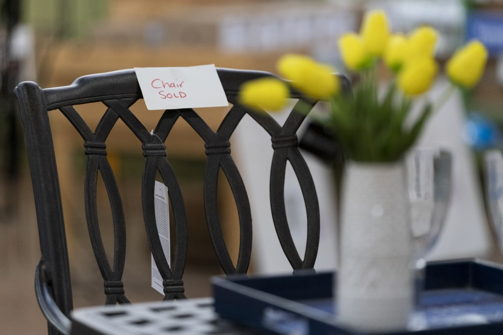 In this July 6, 2021, photo a sign is seen on a sold patio furniture floor model at Valley View Farms in Cockeysville, Md. The garden supply store in ...