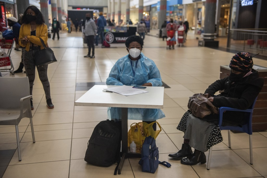Patients wait to be vaccinated against COVID-19 in Hammanskraal, South Africa, Tuesday, July 6, 2021. New vaccination centres are being opened as Sout...