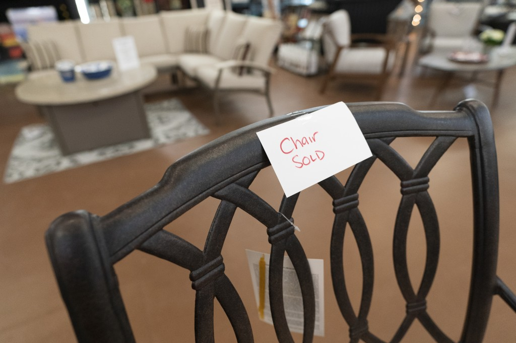 In this July 6, 2021, photo a sign is seen on a sold patio furniture floor model at Valley View Farms in Cockeysville, Md. People used to go to Valley...