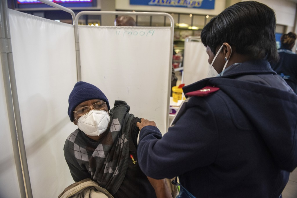 A patient is vaccinated against COVID-19 in Hammanskraal, South Africa, Tuesday, July 6, 2021. New vaccination centres are being opened as South Afric...