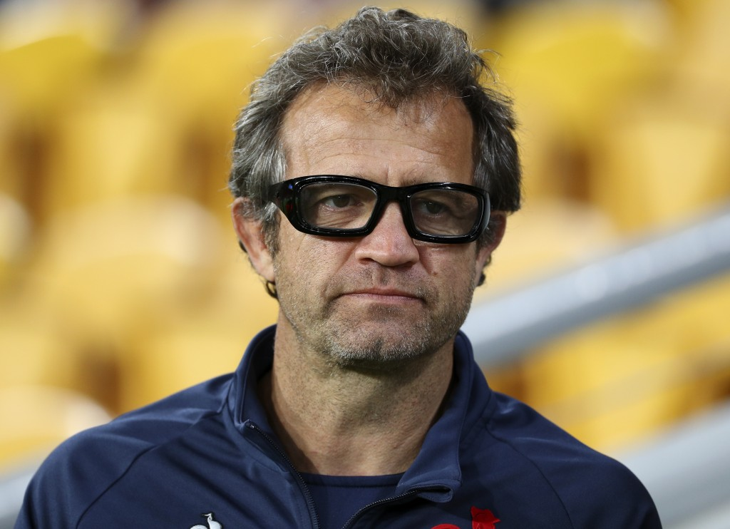 French coach Fabien Galthie watches his players warm up ahead of the rugby international between France and Australia at Suncorp Stadium in Brisbane, ...