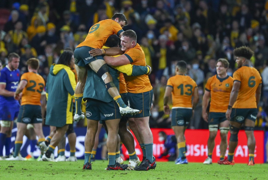 Australian players celebrate following the rugby international between France and Australia at Suncorp Stadium in Brisbane, Australia, Wednesday, July...