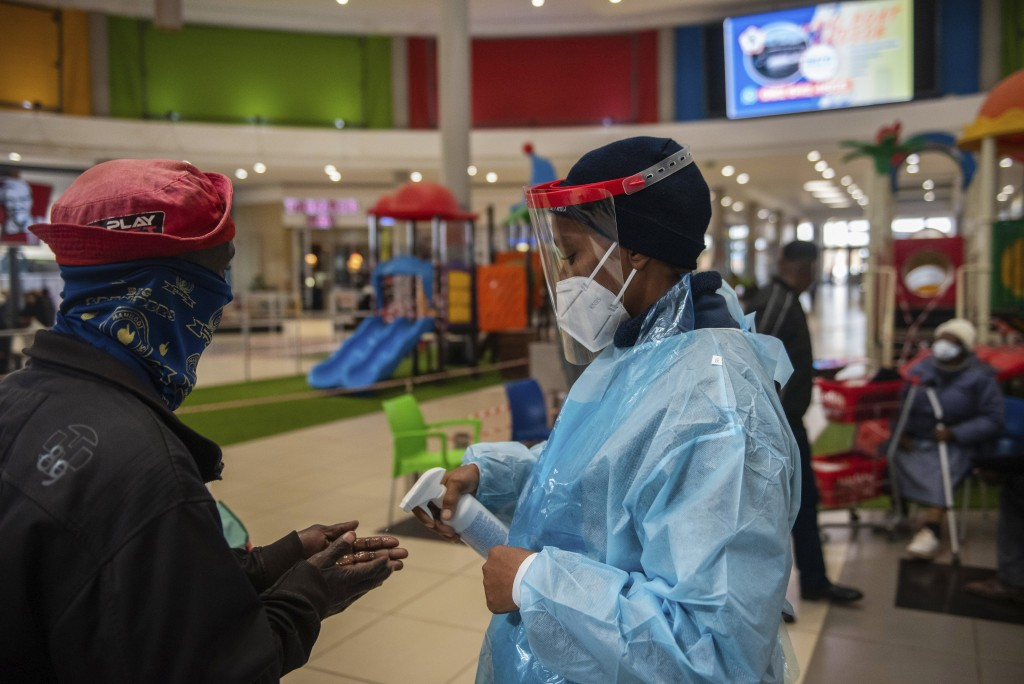 A health care worker prepares to vaccinate a patient using the Pfizer vaccine against COVID-19 in Hammanskraal, South Africa, Tuesday, July 6, 2021. N...