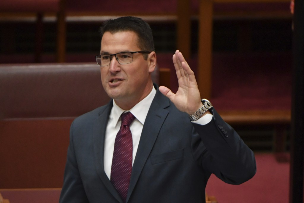 FILE - In this Feb. 17, 2021, file photo, Australian Minister for International Development Zed Seselja gestures in the Senate chamber at Parliament H...