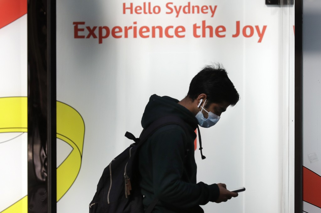A man wears a mask as he walks in Sydney, Wednesday, July 7, 2021.