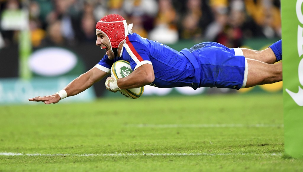 Gabin Villiere of France dives over to score a try during the rugby international between Australia and France at Suncorp Stadium in Brisbane, Wednesd...