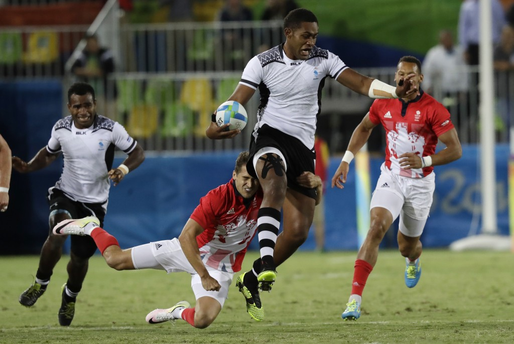FILE - In this Aug. 11, 2016, file photo, Viliame Mata of Fiji evades a tackle during the gold medal mens rugby sevens match against Britain at the 20...