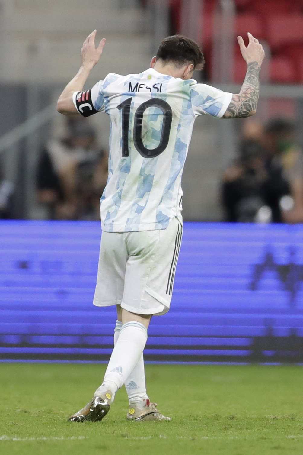 Blood is seen in an ankle of Argentina's Lionel Messi as he reacts during a Copa America semifinal soccer match against Colombia at the National stadi...