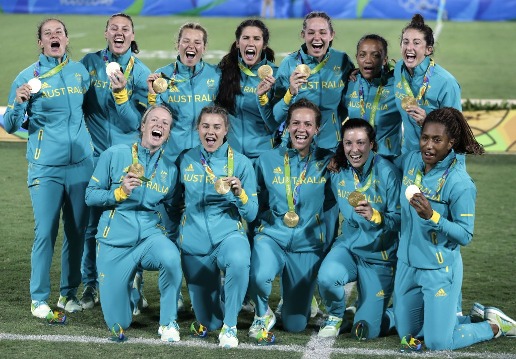 FILE - In this Aug. 8, 2016, file photo, Australia's players celebrate after winning the women's rugby sevens gold medal match against New Zealand at ...