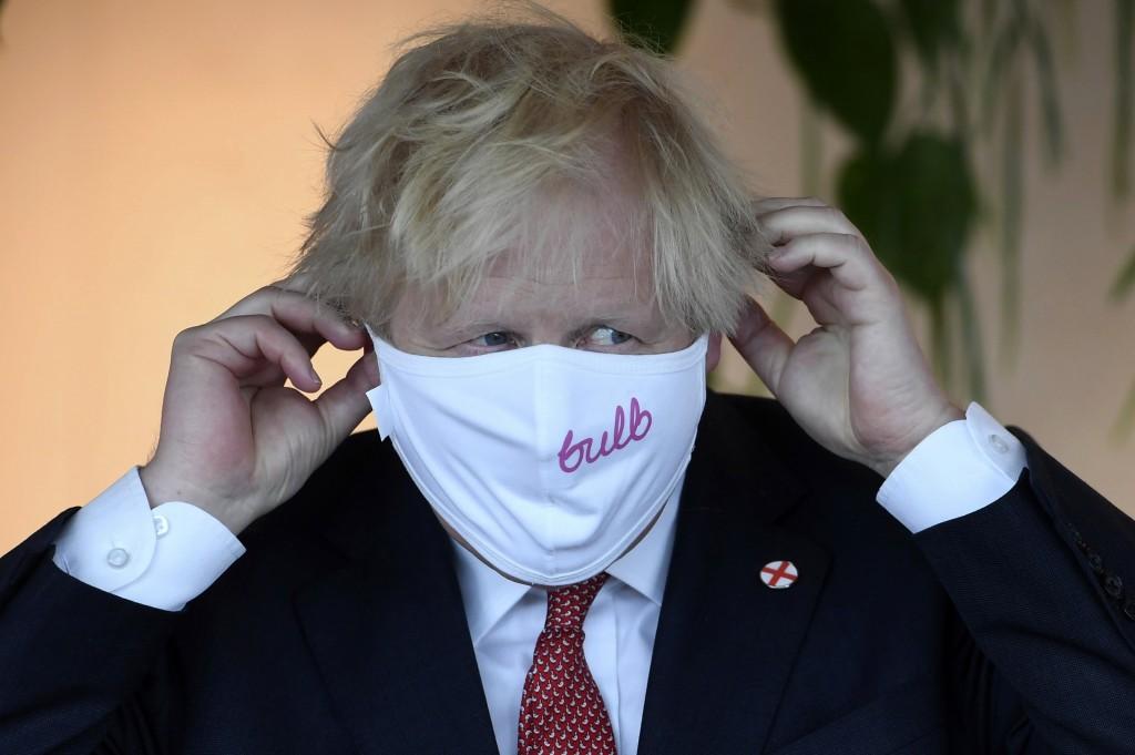 Britain's Prime Minister Boris Johnson visits the energy company Bulb in central London, Thursday July 8, 2021. (Jeremy Selwyn/Pool via AP)
