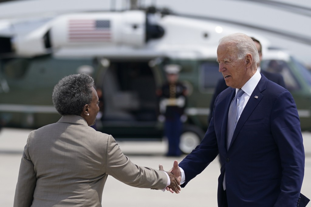 President Joe Biden greets Chicago Mayor Lori Lightfoot, as he arrives at O'Hare International Airport, Wednesday, July 7, 2021, in Chicago. (AP Photo...