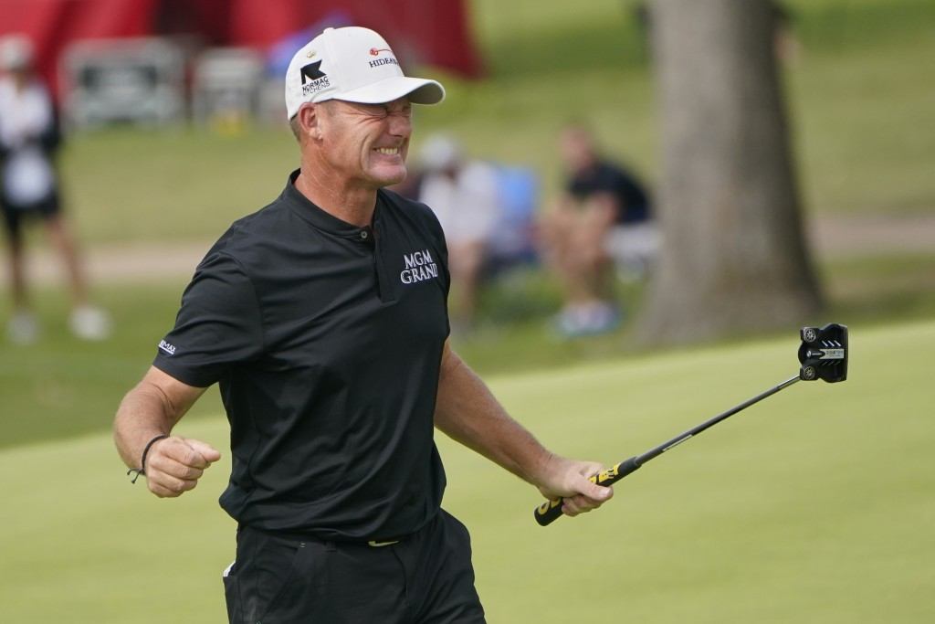 FILE - Alex Cejka celebrates on the 18th green after winning the Senior PGA Championship golf tournament in Tulsa, Okla., in this Sunday, May 30, 2021...