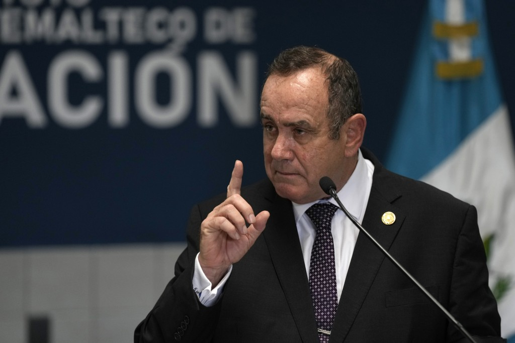 Guatemalan President Alejandro Giammattei speaks at a new facility to receive deported Guatemalans at La Aurora Air Force base during its inauguration...
