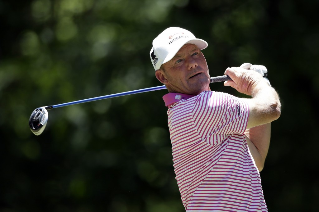 FILE - Alex Cejka, of Germany, tees off on the seventh hole during the final round of the Regions Tradition Champions Tour golf tournament in Hoover, ...